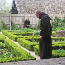 Benedictine monk tending herbal garden